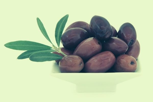 kalamata olives served in small plate after storing